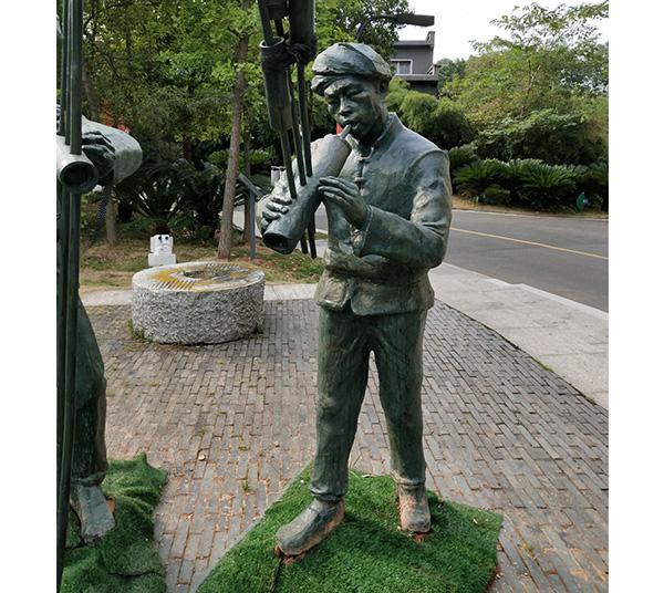 吹揍人物铜雕